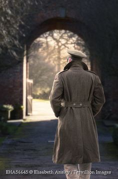 Trevillion Images - wwii-soldier-walking-towards-archway