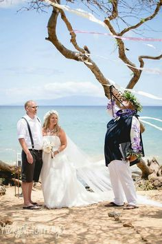 Married by Hawaiian royalty overlooking the beautiful ocean on Maui. Ribbons floating through the breeze. It was breathtaking.