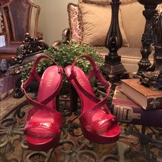 """Lauren Red Sandals Lauren by Ralph Lauren red high heels. Very cute sandals with gold buckle on side. 5"""" heels with approximately 1"""" platform. Leather is red with black markings.  Cushioned for comfort.  Worn once no damage or sign of wear.  Great condition. Lauren Ralph Lauren Shoes Heels"""
