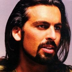 Oded Fehr.. yes, I place him on here twice. Either way short or long hair the man is hot!