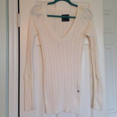 American Eagle Sweater Nikkolette closet: this is a American Eagle cream colored lightweight v-neck sweater . Size small in excellent condition no holes or stains . I do not trade or use other apps or PayPal . I do take offers and bundle though. American Eagle Outfitters Sweaters