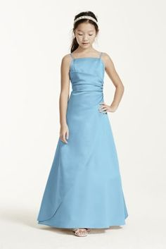This long satin ball gown has a overlay and ruching at the side seam. The spaghetti straps keep this dress simple. This dress will look great with our Bridesmaids ball gown styles. This style features an adjustable fit for added flexibility and comfort with fewer alterations. Fully lined. Imported polyester. Dry clean.