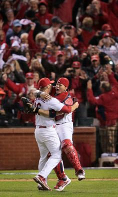 St. Louis Cardinals relief pitcher Trevor Rosenthal and St. Louis Cardinals catcher Yadier Molina celebrate the Cardinals victory in Game 6 ...
