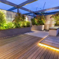 terrace garden Roof Terrace Design penthouse apartment Kings Cross development, expanse of decking storage benches and planters Terrace Garden Design, Rooftop Design, Rooftop Terrace, Deck Design, Deck Storage, Storage Benches, Diy Terrasse, Penthouse Apartment, Pergola Designs