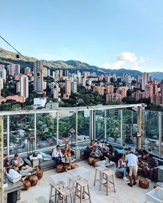 Medellin, also dubbed as the city of eternal spring, is home to some of the coolest brick coloured high rise buildings, chic coffeeshops… Best Rooftop Bars, Brick Colors, Spa, High Rise Building, Coffee Travel, South America, Dolores Park, Exterior, City