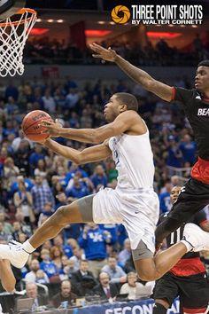 Kentucky's @AaronICE2 spins and twists his way to the hoop past Cincinnati defenders -