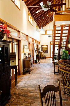 Antique brick pavers near foyer created to feel like a narrow Italian street.