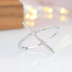"""This standard silver horizontal ring cubic zirconia wedding ring is made from 925 sterling silver and shiny white cut AAA cubic zirconia. The cross loop is one of the most popular rings of the year. The ring's exquisite sheen and simple, stylish """"X"""" design are stunning and a symbol of eternal love. Womens Wedding Bands, Wedding Ring Bands, Cubic Zirconia Wedding Rings, Love Knot Ring, Tungsten Mens Rings, White Topaz Rings, Engagement Bands, Gold Plated Rings, Ring Designs"""
