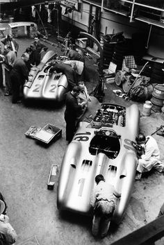 French #GrandPrix. Reims, France. 4 July 1954. The cars of Hans Herrmann, #MercedesBenz W196 22, retired, and Juan Manuel Fangio, #MercedesBenz W196 18, 1st position, being worked on in the garage.