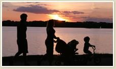 A family enjoys a beautiful sunset on Lake Norman. Photo from VisitLakeNorman.org, where you can find lots of stuff to do around the Lake Norman area.
