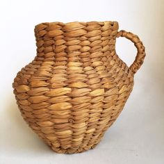 A personal favorite from my Etsy shop https://www.etsy.com/listing/467377231/woven-banana-leaf-basket-pitcher