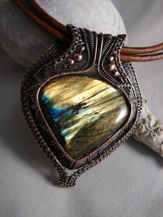 Gorgeous flashy labradorite, wrapped in copper with a double strand of 3mm leather measuring at 20. Any further info or pictures needed just ask.