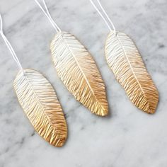 These Anthropologie inspired feather ornaments are a fun Christmas craft with polymer clay.