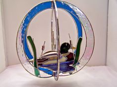 https://flic.kr/p/4prU32 | 2-1-08 mallard duck on pond stained glass suncatcher | Lovely mallard duck on pond with cat tails, beautiful blues capture the light!  For more information on where to get this piece please check my profile for the link to my Etsy web page.
