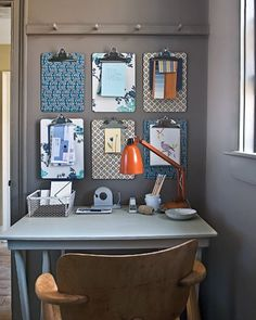 Keep your desk tidy by decorating your walls with pretty clipboards. Clip all those loose papers out of your way instead of leaving them to clutter your work space. A great alternative to a bulletin board - no pin holes in your papers!- maybe don't need six clipboards, but a couple would be cute!