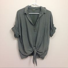 """Brandy Melville Army Green Tie Front Shirt Deep """"V"""" blouse with a front tie. This is one size fits most, but it seems to best fit around a small or medium. Great for dressing up or down. Brandy Melville Tops Blouses"""