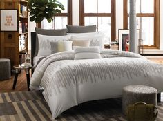 The Frost #bedding is elegantly embroidered with geometric patterns on cool earth-tone hues. #KCRH