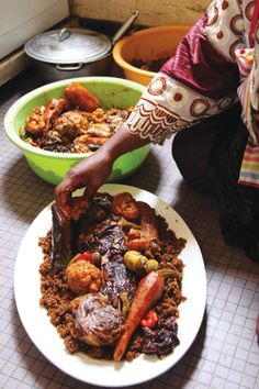 Thieboudienne (Senegalese Fish and Rice) Recipe - Saveur.com :: The national dish of Senegal, this boldly flavored combination of fish, rice, and vegetables simmered in tomato sauce is a hearty one–pot meal. You can make it with any fish or vegetables you have on hand, including potatoes, cassava, squash or pumpkin, and plantains.