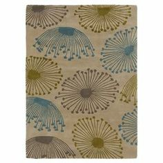 """Add a pop of pattern to your living room or den with this hand-tufted wool rug, showcasing an oversized floral motif in olive and teal.  Product: RugConstruction Material: 100% WoolColor: Olive, teal and mossFeatures:  Hand-tuftedMade in IndiaPile Height: 0.67"""" Note: Please be aware that actual colors may vary from those shown on your screen. Accent rugs may also not show the entire pattern that the corresponding area rugs have.Cleaning and Care: Vacuum regularly with non-beater attachment…"""