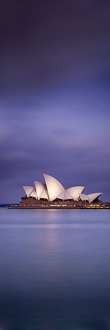 The Sydney Opera House illuminated by the lights late one evening
