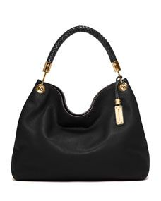 """Black grained leather. Golden hardware. Braided top handle with rings; 10"""" drop. Shoulder strap. Hanging braided logo tag. Magnetic snap top closure. Inside, polyester lining; one zip and two open pockets. 11 1/2""""H x 14 3/4""""W x 6""""D."""