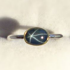 Star Blue Sapphire Ring 18k Gold and Sterling by JanishJewels -- I have always loved star sapphires. They seem kinda rare.