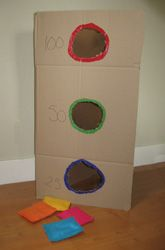 Take a simple game like beanbag toss and incorporate a learning component to improve your preschooler's number recognition skills. Help your child learn her numbers and develop her hand-eye coordination. This is a great game to play outdoors and with plenty of people. So invite the whole family to join in the number fun!