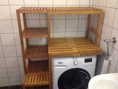 """Storage around the washing machine. Materials: For this hack you need 2 Molger shelves and 1 (or 2, I used 1) Molger benches.  Saws, drill, screws, nails and """"brackets"""".Description: After moving w"""