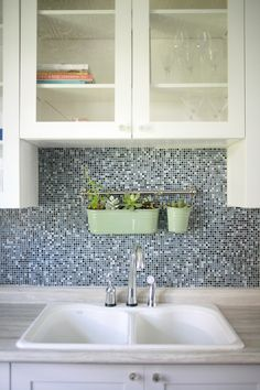 Don't have a window above your kitchen sink? No problem - create your own greenery and faux window sill by installing hanging #kitchen succulents.