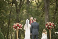 A garden ceremony under the majestic oak trees at Salisbury House and Gardens.  Photo courtesy of Ivory + Bliss.