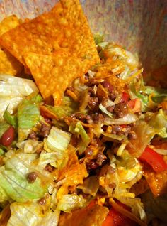 Taco Salad, with Doritos! -- BEST salad ever. This salad has been in my family for years. We use thousand island dressing instead. Great for potlucks and picnics.