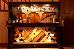 The Wellington piano was our first completed wine & cocktail bar. This piano features an inlayed granite countertop, recessed LED lighting, a