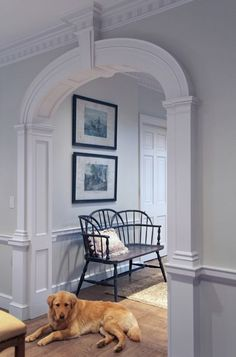 Awesome arched doorway takes center stage with classic Colonial trimwork. Designed by Hull Historical on Houzz.