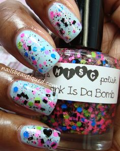 Lisa Frank Is Da Bomb- glitters in blue, black, pink, neon lime green,  black hearts, silver holo hearts in a clear baseon top of NYC Skyline Blue sold on etsy