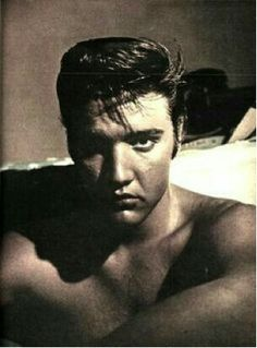 Elvis in 1956 having a photo shoot in a room at the 'Peabody Hotel' Memphis