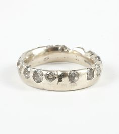 @Polly Wales, Wide Band White gold Ring with White Sapphires. Available at www.catbirdnyc.com.