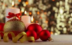 Buy Christmas Balls and Burning Candles by GoodMan_Ekim on VideoHive. Iridescent background without focus. Red and gold Christmas balls lie before white burning candles