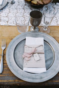 zinc place setting, photo by Cinzia Bruschini http://ruffledblog.com/intimate-italian-wedding-with-rustic-details #placesetting #weddingideas