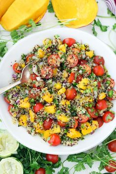 Served cold, this refreshing Mango Quinoa Salad is the perfect sweet/spicy balance, with jalapeños, cilantro, onion, and tomatoes. Make this vegan recipe ahead of time and serve straight out of the fridge! It's amazing paired with a spicy protein, like blackened tilapia or jerk chicken. #vegan #mango #salad #quinoa