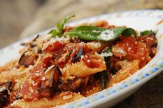 Pasta alla Norma  A classic Sicilian pasta dish cooked with tomatoes, fried eggplant, ricotta and basil.