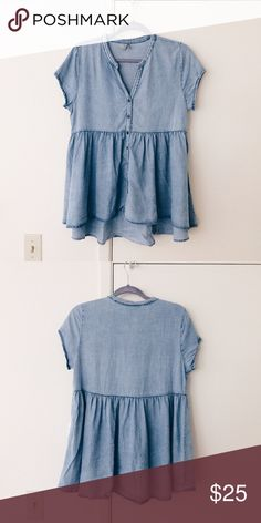 Paper Crane Chambray Button Down Pullover Chambray babydoll style pullover button down shirt with ribbon detailing and peplum hem. By the brand Paper Crane found at Anthropologie. Anthropologie Tops Blouses