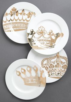 Emily's Fête for a Queen Plate Set. Any Anglophile is sure to flip her sugar cubes over this ceramic plate sets baroque crowns, which name the presenter of their contents the princess of her party. #white #modcloth