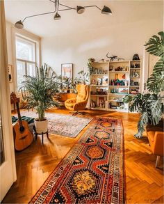 Best way to cozy up a big space: patterned rugs and lots of plants. Design goals by via Boho Living Room, Living Room Decor, Retro Living Rooms, Bohemian Dorm Rooms, Bohemian Bedroom Decor, Small Living Rooms, Modern Living, Deco Retro, Room Decor Bedroom