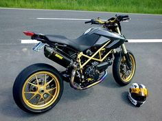 Ducati Hypermotard Carbon  Gold (These are the colors of my husband's Triumph.)