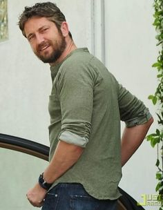 Bretton Keith's character in Seeking Solace was a bit influenced by the hunky Gerard Butler, I have to admit. <3  www.adriennedunning.com