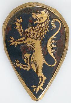 Badge of Recognition, Italian or Spanish, 1300. Badge (divisa, insignia, placa) Usada  como como colgante ornamental en los arreos del caballo.  Metropolitan Museum of Art