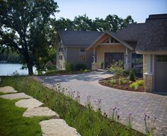 This beautiful Belgard driveway gives this picturesque home added curb appeal.