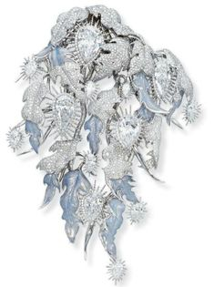 'WHITE LIGHT' DIAMOND BROOCH, DESIGNED BY SHAUN LEANE.   With thirteen pear-shaped diamonds, each in icicle style collet setting, to the foliate surround, some leaves pavé-set with diamonds, some applied with light blue opalescent enamel, mounted in 18k white gold, 2009, 12.5 cm high Signed Shaun Leane, engraved 'White Light'
