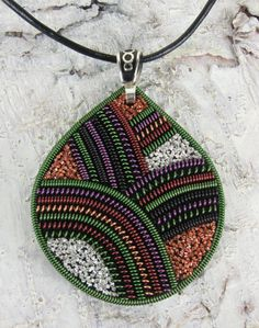 Metal thread pendant by TanjasHandEmbroidery