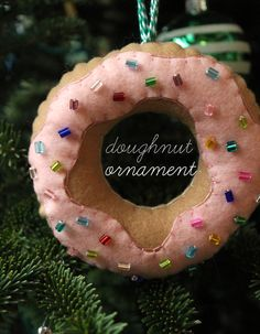DIY Felt Doughnut Ornaments - I think we should put up a fun tree of some sort -branches in a large pot or even use the small artificial trees I have for X-mas and then cover it in all kinds of candy and candy lights? Christmas Ornaments To Make, Felt Ornaments, Christmas Holidays, Christmas Crafts, Christmas Decorations, Homemade Ornaments, Christmas Tree, Winter Holidays, Christmas Ideas